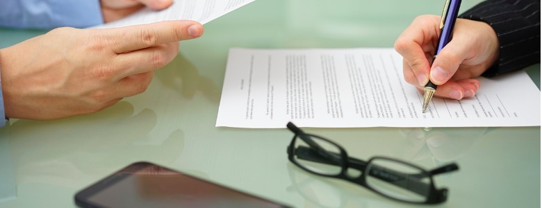 businessman-and-woman-are-reading-and-signing-contract-picture-id522802928.jpg