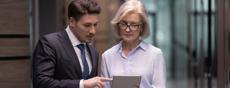two-business-professionals-looking-at-tablet