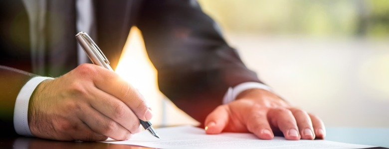 signing-legal-document-picture-id693881068.jpg