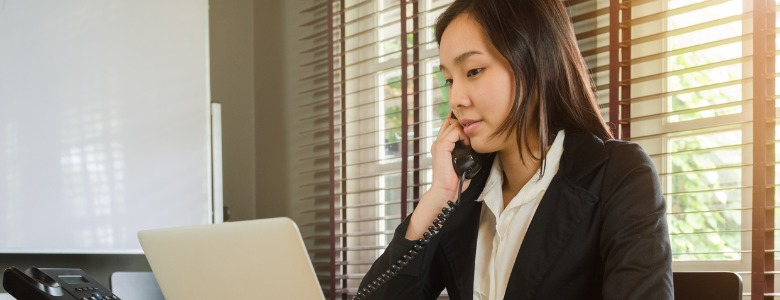 woman-working-in-office-and-talking-telephone