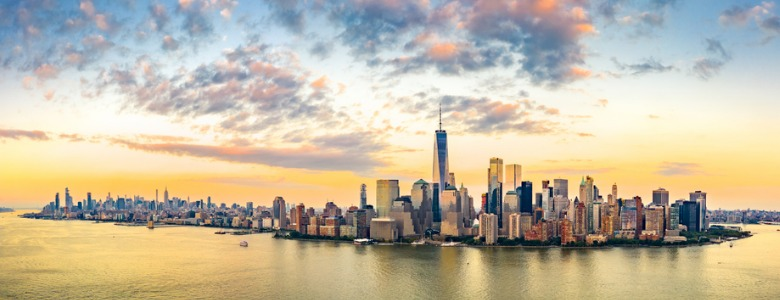 aerial-panorama-of-new-york-city-skyline-at-sunset-picture-id1071263666