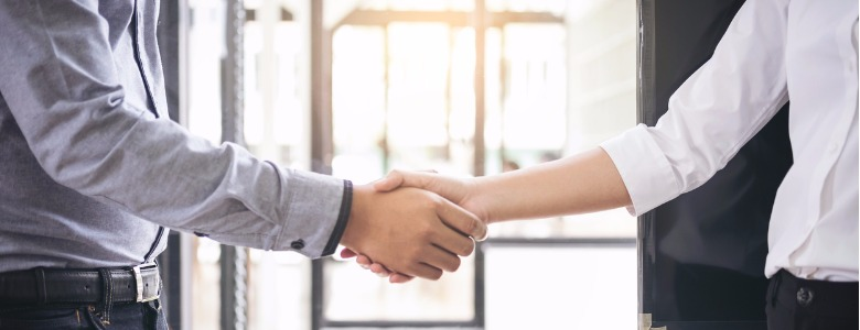 two-businesspeople-shaking-hands-during-a-meeting-in-the-office-picture-id887801638-1.jpg